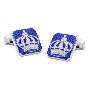 Beautiful Crown Cufflinks with little Jewels agains a blue fibre carbon background